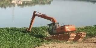 إزالة نبتة زهرة النيل في محافظة صلاح الدين