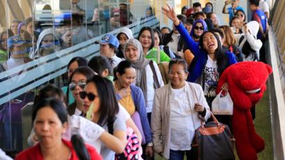 The Philippines is preparing to evacuate 2.3 million of its citizens working in Iraq, Iran and neighboring Arab countries Image
