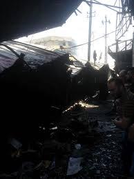 فرق الدفاع المدني تسيطر على حريق نشب في مخازن تجارية وسط بغداد