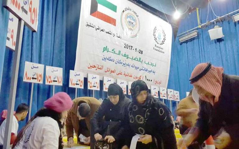 توزيع 1000 قسيمة شرائية مقدمة من الجمعية الكويتية للاغاثة بين النازحين