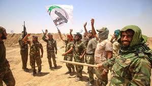 لواء تابع للحشد يقطع طريقا استراتيجياً ويتظاهر في ديالى