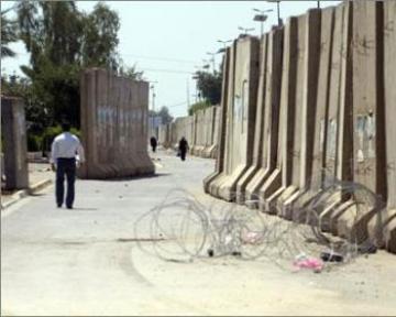 الربيعي ينفي أي وجود لاشكالات مع الداخلية ويؤكد استمرار بناء السور الأمني حول بغداد
