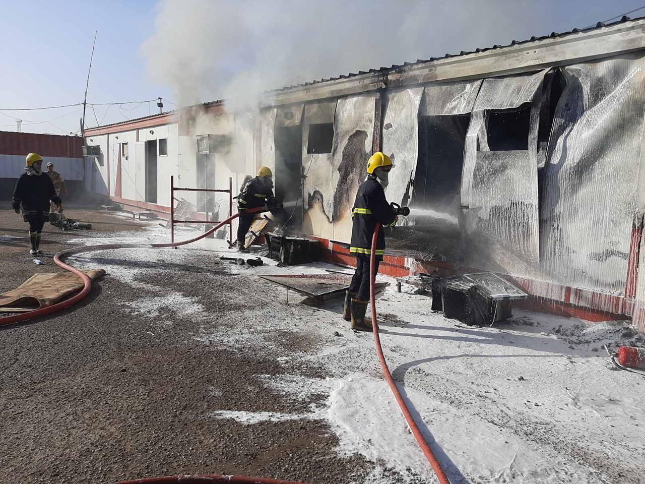 بالصور  .. انقاذ مشجب اسلحة من حريق بفوج للشغب في مطار المثنى وسط بغداد