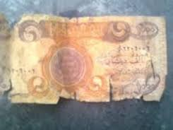 Damaged Iraqi dinars behind the scarcity in the domestic market