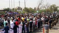 """بالصور : متظاهرو النجف يسخرون من وزير الكهرباء """" طفوا الكيزر يا مواطنين """""""