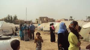 القوات الأمنية تعيد 113 عائلة نازحة من مخيمات النازحين الى مناطقها في القائم