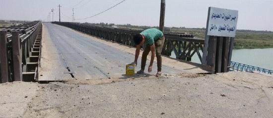 مطالب بصيانة الشارع الرئيسي الذي يربط ميناء ام قصر بالطريق الدولي