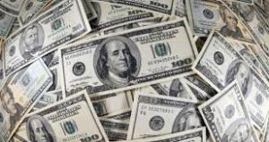 إنخفاضاً طفيفاً لسعر صرف الدولار مقابل الدينار العراقي