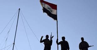 تحرير مجلس ومستشفى القيارة  ورفع العلم العراقي عليها
