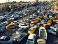 شوارع بغداد مكتظة بالسيارات وتتزامن هذه الازدحامات مع قرار فتح الشوراع الرئيسية المغلقة من سنوات