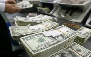 إنخفاض طفيف للدولار اليوم الى 1254 ديناراً