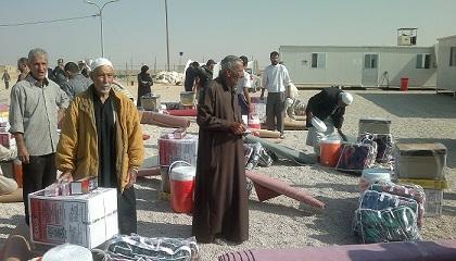 الهجرة توزع 380 حصة من المساعدات الغذائية لنازحي الانبار
