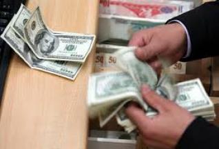 إرتفاع طفيف للدولار اليوم الى 1252 دينارا
