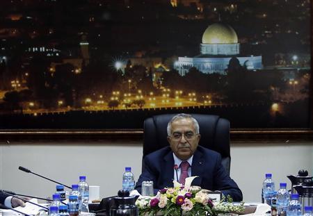 فياض يدعو إلى الإسراع في إجراء الانتخابات الفلسطينية