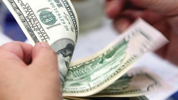 Dollar falls to lowest level in more than two months after disappointing US data